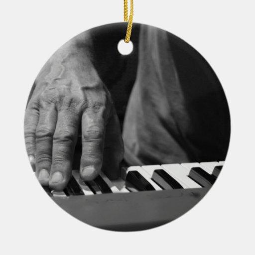 hand playing keyboard bw male music christmas ornaments