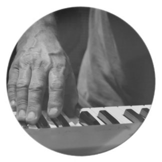 hand playing keyboard bw male music party plates