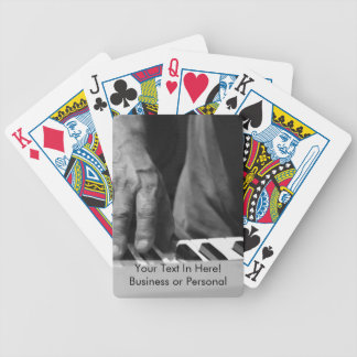 hand playing keyboard bw male music deck of cards