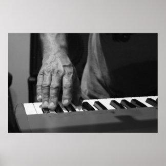 hand playing keyboard bw male music print