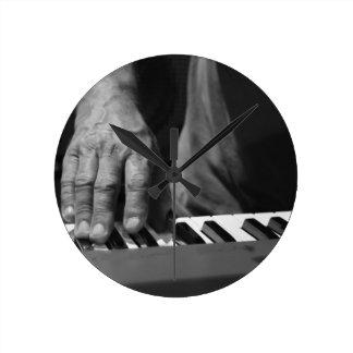 hand playing keyboard bw male music round clock