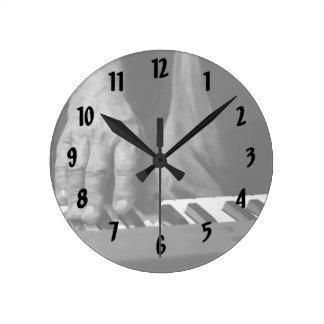 hand playing keyboard bw male music round clocks