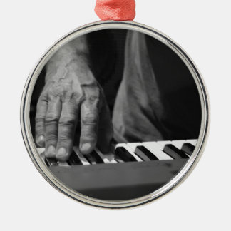 hand playing keyboard bw male music round metal christmas ornament