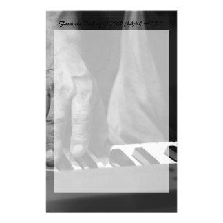 hand playing keyboard bw male music stationery