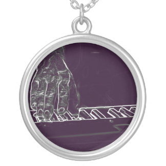 hand playing keyboard purple white ink outline silver plated necklace