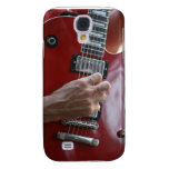 Hand playing red electric guitar near pickup samsung galaxy s4 case