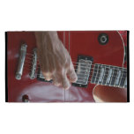 Hand playing red electric guitar near pickup iPad folio cover