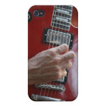 Hand playing red electric guitar near pickup cover for iPhone 4