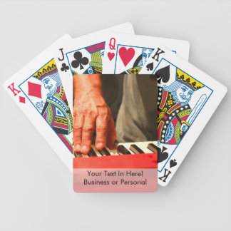 hand playing red keyboard male musician bicycle playing cards