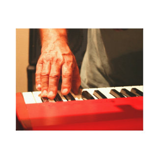 hand playing red keyboard male musician canvas print