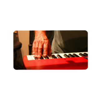 hand playing red keyboard male musician address label