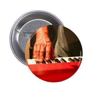 hand playing red keyboard male musician pinback button