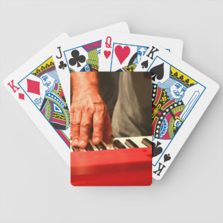 hand playing red keyboard male musician bicycle card deck