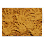 Hand prints on the beach greeting card