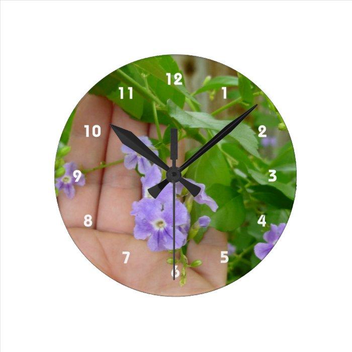 Hand, purple flowers, leaves round clock