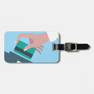 Hand swiping credit card luggage tag