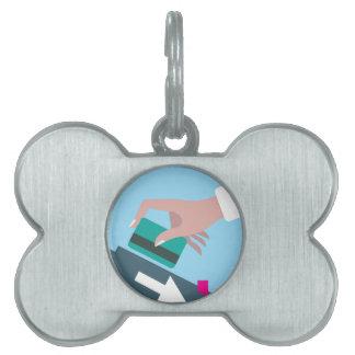 Hand swiping credit card pet name tag