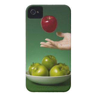 hand tossing red apple in the air and green iPhone 4 cases