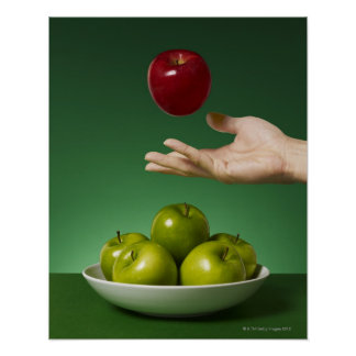 hand tossing red apple in the air and green poster