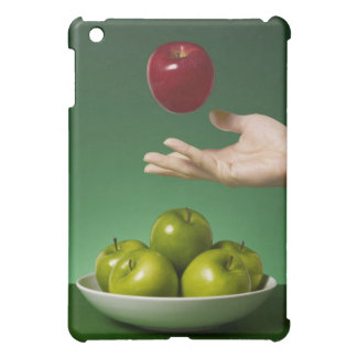 hand tossing red in the air and green cover for the iPad mini