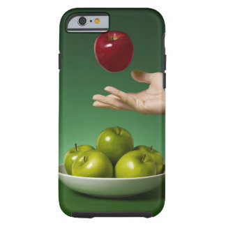 hand tossing red in the air and green tough iPhone 6 case