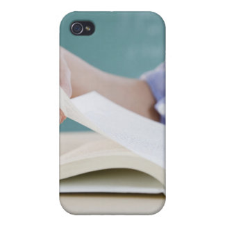 Hand turning page in book cover for iPhone 4