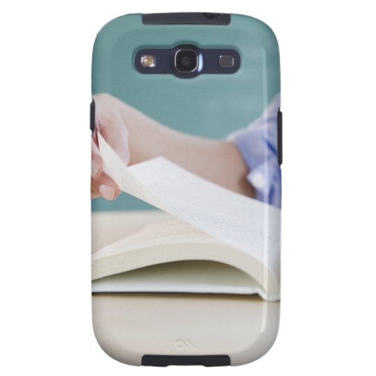 Hand turning page in book galaxy SIII case