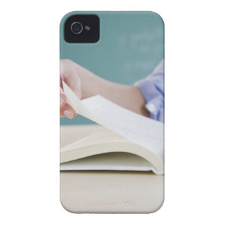 Hand turning page in book iPhone 4 cover