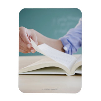 Hand turning page in book vinyl magnet