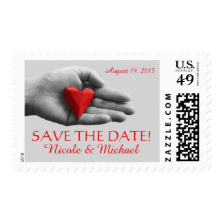 Hand with red heart. Save the Date Postage. Postage