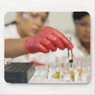 Hand with test tubes mouse pad