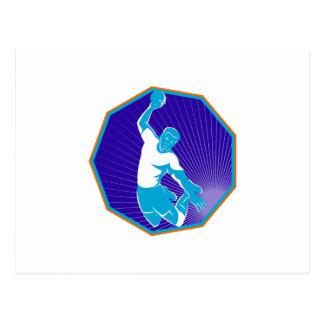 handball player jumping throwing ball postcard