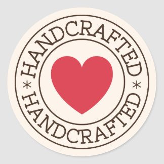 Handcrafted, brown stamp design with red heart classic round sticker