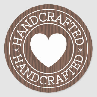 Handcrafted, white stamp with heart on dark wood classic round sticker