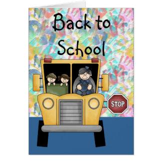 Handprints y autobús escolar de nuevo a tarjeta de