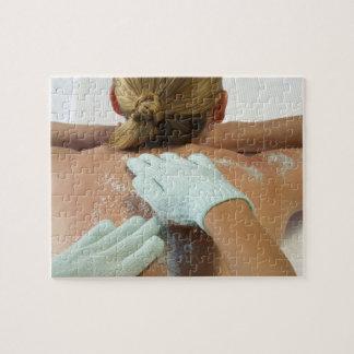 Hands applying exfoliating scrub jigsaw puzzles