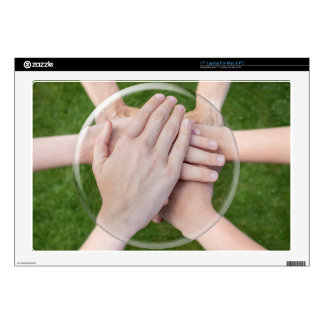 Hands arms uniting in glass sphere decal for laptop