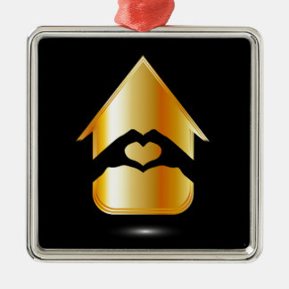Hands forming a heart in a house square metal christmas ornament