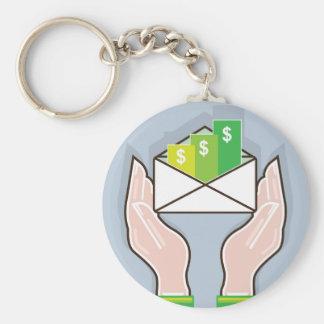 Hands giving receiving checks inside an envelope keychain