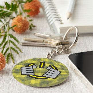 Hands Gripping a Power Symbol Keychain