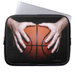 Hands holding a basketball computer sleeves