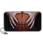 Hands holding a basketball iPhone speakers