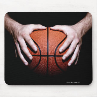 Hands holding a basketball mouse pad