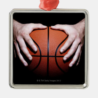Hands holding a basketball square metal christmas ornament