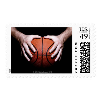 Hands holding a basketball postage stamp
