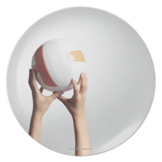 Hands holding a volleyball,hands close-up dinner plate