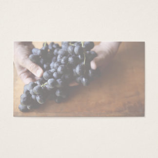 hands holding grapes business card