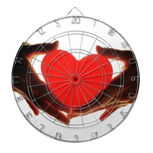 Hands holding heart dartboard with darts