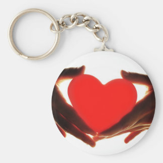 Hands holding heart keychain