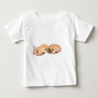 Hands holding model human brain on white baby T-Shirt